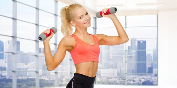 fitness, sport, fitness and people concept - smiling woman with