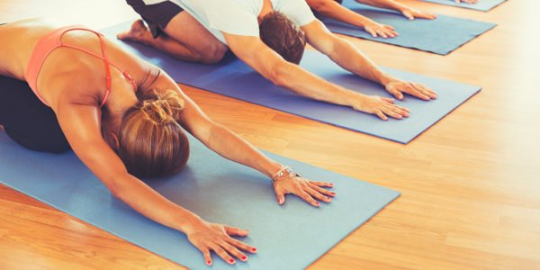 Yoga Class, Group of People Relaxing and Doing Yoga. Child's Pos