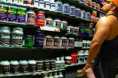 Man Looking in Supplements at Store