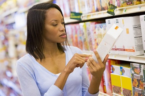 Woman Checking Label on Product