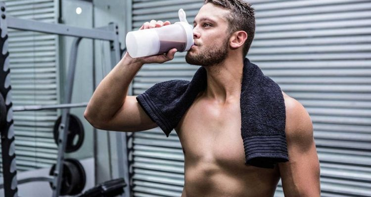 Man in Gym Drinking Protein Shake