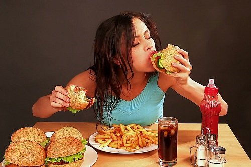 Young Woman Eating Junk Food